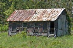 tin för övergivet tak för kabin rostig arkivfoto