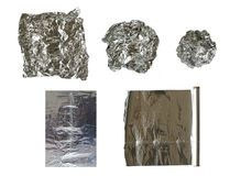 Tin foil. I five different executions: lightly crumpled, more crumpled, crumpled into a ball, one leaf and an unfolded roll of Royalty Free Stock Image