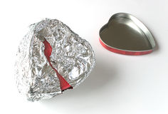 Tin foil heart can. A canister shaped like a heart wrapped in tin foil Stock Photography