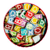 Tin full of colorful handmade ceramic letters Stock Image