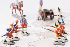 Tin games. Soldiers oit of tin in traditional unifroms of the napoleon wars, miniature figures of toy soldiers, collection and arrangement on battelfield Royalty Free Stock Photos