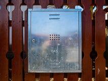 Tin gas box on residentual house wooden fence. Tin gas box on residential house wooden fence close up shot stock photos