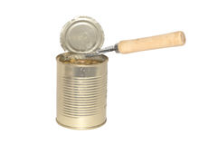 Tin with green peas and a can opener. Stock Photo