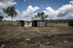 Tin houses near the road under a thunderstorm in Africa Stock Photography