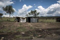 Tin houses near the road under a thunderstorm in Africa. Tin houses near the road in Africa in central Kenya Stock Photography