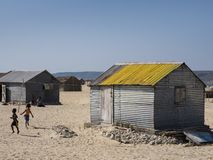 Tin huts and children in the village stock photography