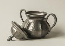 Tin Jug. A vintage tin jug with a cover Stock Image