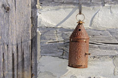 Tin Lantern 1. Paul Revere tin lantern hung out side the front door of old log cabin. Beautiful design form simpler times Royalty Free Stock Image