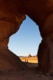 Tin Lebbo Arch - Natural Rock Arch - Akakus, Libya. Tin Lebbo Arch - Huge natural rock arch dwarfs two people - Akakus (Acacus) Mountains, Sahara, Libya royalty free stock image