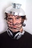 Tin Man. Man with tin hat and cable wrapped around his face royalty free stock photos