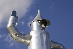 Tin Man. A statue of a man made from tin- blue sky background Royalty Free Stock Photo