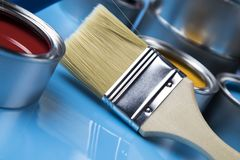 Paint brush, tin can and color guide samples. Tin metal cans with color paint and paintbrush Royalty Free Stock Image
