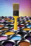 Paint brush, tin can and color guide samples. Tin metal cans with color paint and paintbrush Stock Photo