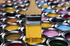 Paint brush, tin can and color guide samples. Tin metal cans with color paint and paintbrush Stock Photos