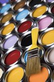 Paint brush, tin can and color guide samples. Tin metal cans with color paint and paintbrush Royalty Free Stock Photography