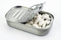 Tin metal contains white pills Stock Image