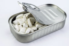Tin metal contains white pills Royalty Free Stock Images