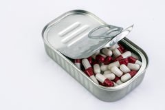 Tin metal contains white pills and red Royalty Free Stock Images