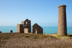 Tin mine on horizon Cornwall coast England UK Stock Photos