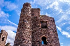 Tin Mine Ruins at St. Agnes. Stamps and wheel engine house ruins Wheal Coates mine on cliffs near St. Agnes, Cornwall, UK royalty free stock photo