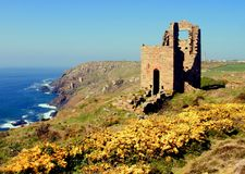 Tin Mines, Cornwall, England. Landscape view of ruined tin mines on a cliff with the sea as a background Royalty Free Stock Photos