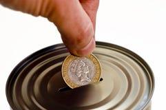 Tin money box. Tin can savings money box Stock Images