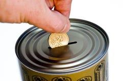 Tin money box. Tin can savings money box Royalty Free Stock Images