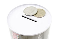 Tin money box with coins Royalty Free Stock Image
