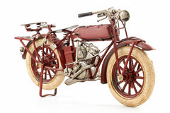 Tin motorcycle model. Handmade tin 1930's vintage motorcycle model, isolated over white background Stock Photography