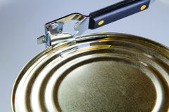 Tin opener opening a can of food Royalty Free Stock Photography