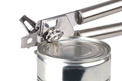 Tin opener opening a can Royalty Free Stock Images