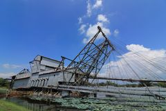 Tin ore dredger. Abandoned tin ore dredger now on display in Tanjung Tualang,  Perak, Malaysia Royalty Free Stock Photography