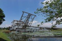 Tin ore dredger. Abandoned tin ore dredger now on display in Tanjung Tualang,  Perak, Malaysia Stock Image