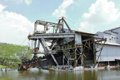Tin ore dredger. Abandoned tin ore dredger now on display in Tanjung Tualang,  Perak, Malaysia Stock Photography