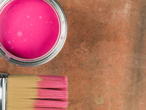 Tin of Pink Paint and a Paint Brush Stock Image