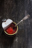 Tin with red caviar Stock Photography