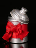 Tin with a red jib. Around on a black background, christmas idea Royalty Free Stock Images