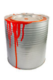 Tin of a red paint. Isolated over white stock images