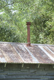 Tin Roof. Vintage tin roof on a retro wooden building Royalty Free Stock Images