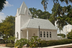 Tin roofed historical church, Florida. Tin roofed historical church, Palmetto, FL, surrounded by tropical trees and foliage Royalty Free Stock Images