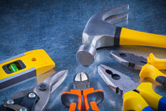 Tin snips gripping tongs nippers hammer and Royalty Free Stock Images