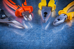Tin snips gripping tongs nippers on scratched Stock Images