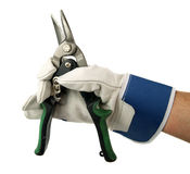 Tin shears. Tin snips shears with green plastic insulated handles with hand Royalty Free Stock Photography