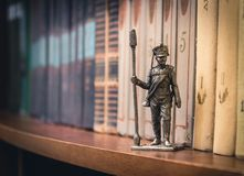 Tin Soldier. Russian foot artillery gunner 1812-1815, year on a bookshelf Royalty Free Stock Images