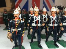 Tin soldiers. Marching Stock Photos
