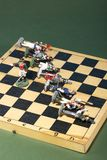 Tin soldiers of the Napoleonic wars of 1812. On a chessboard Royalty Free Stock Image