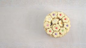 A tin of sweet and colorful cakes food Royalty Free Stock Images