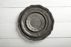 Tin texture plates on table Stock Photos