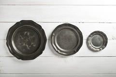 Tin texture plates on table Stock Image