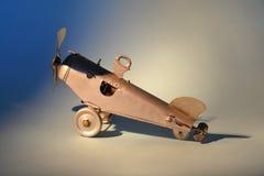 Tin toy aeroplane. Detail of a mechanical tin toy aeroplane stock photos